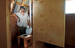 David Bailey helped install a composting toilet in Austin. Sawdust is used to eliminate odor.