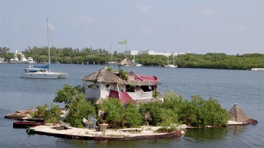 Man Builds Floating Tropical Island Paradise on 150,000 Recycled Plastic Bottles