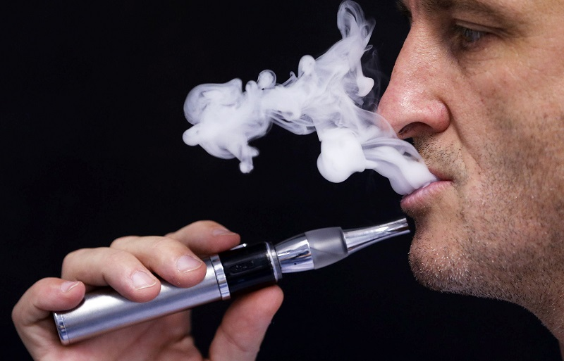 Charly Pairaud, deputy director of Vincent dans les Vapes e-liquids maker, demonstrates the use of an electronic cigarette in his factory in Pessac near Bordeaux