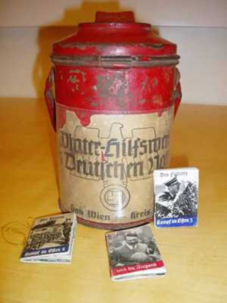 A canister used for collections during the Winter Relief Fund.