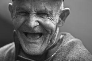 Joyful old man laughing